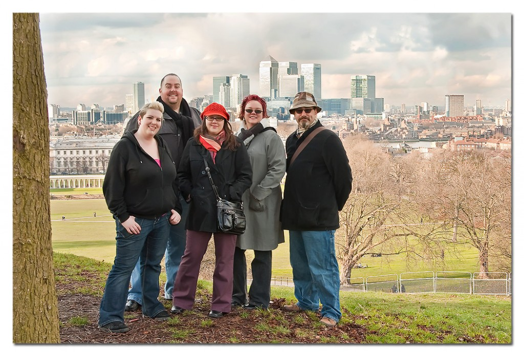 Aileen (left) and friends, and Canary Wharf skyscrapers
